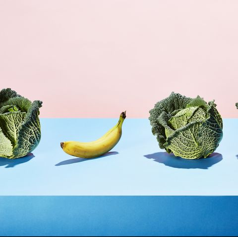A row of cabbages with one banana