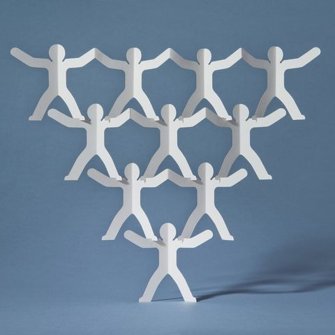 rows of paper cut out men balancing on one