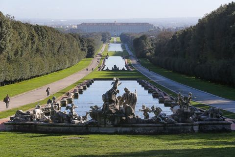 A view of the avenue in Italy's Royal Palace of Caserta, with fountains and pools, in the park