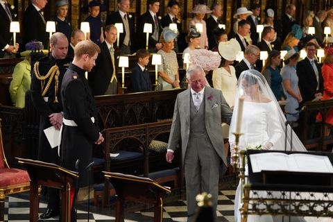 prince harry watches meghan markle walk down the asile