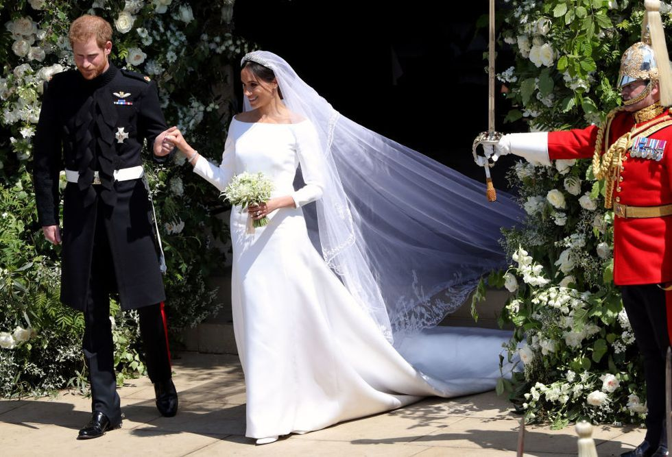 Prince Harry and Meghan Markle walk out of St. George's Chapel