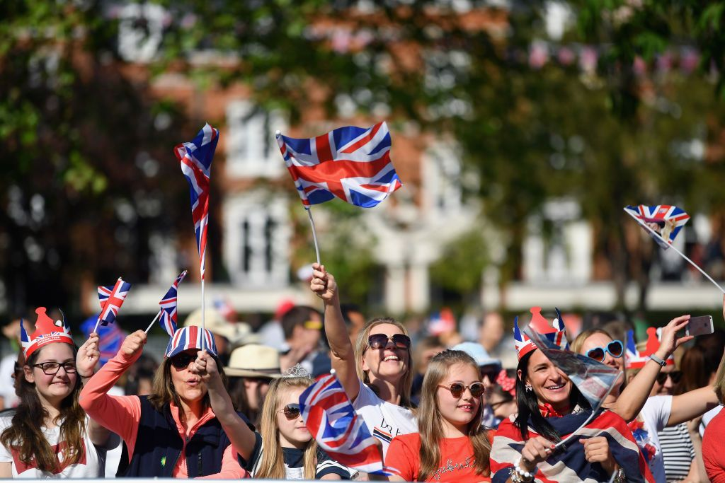 Fans cheering with excitement for the royal wedding.