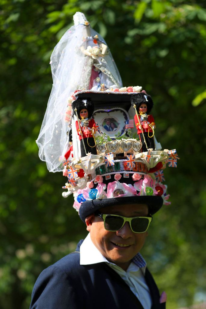 A fan wears a rather wild hat to the royal wedding.