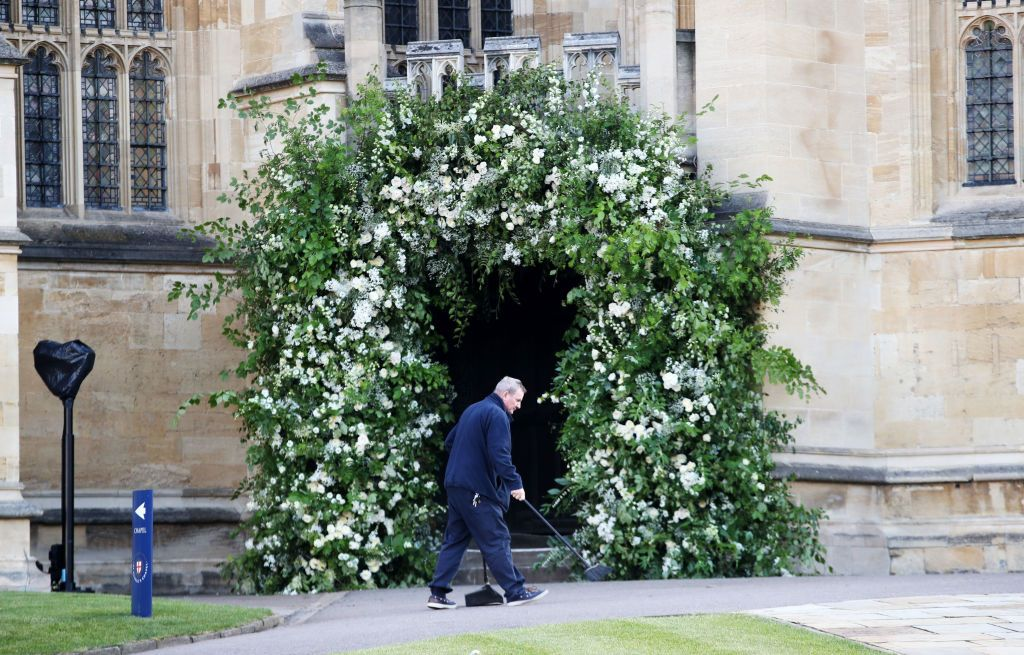 A man sweeps the path outside St George's Chapel in Windsor Castle ahead of the big day.