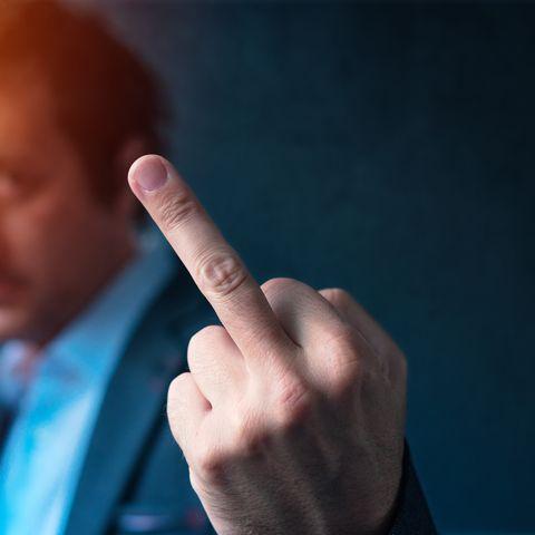 最悪なデート 体験談Rude businessman talking on mobile phone and giving middle finger