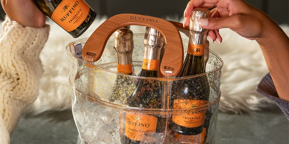 This Gold Sparkly Purse Comes With a Six-Pack of Prosecco, So You're Ready for the Holidays
