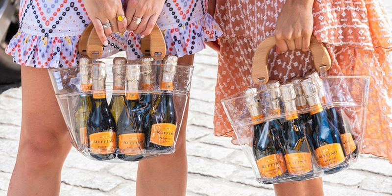 This Prosecco Purse Comes With A Six-Pack Of Bubbly, So You Can Sip On The Go