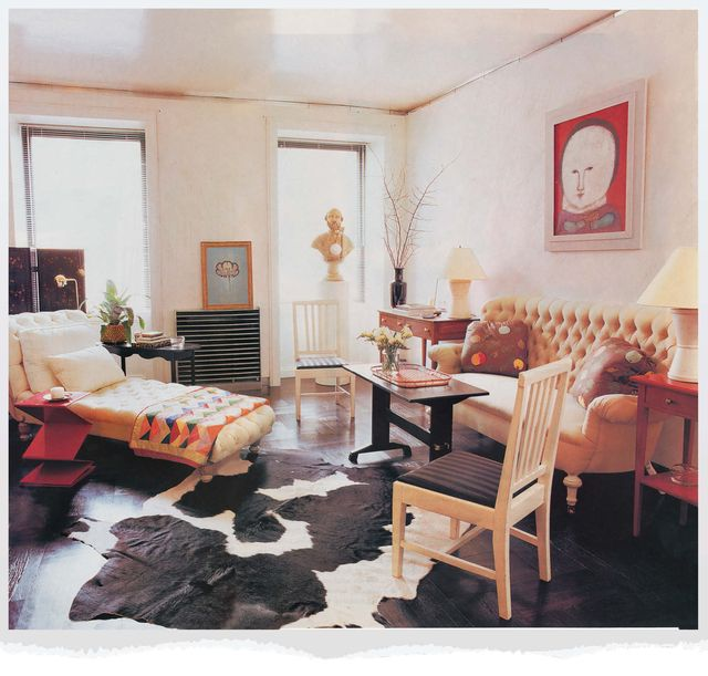 rufino report archive, living room, cow hide rug, wooden chair