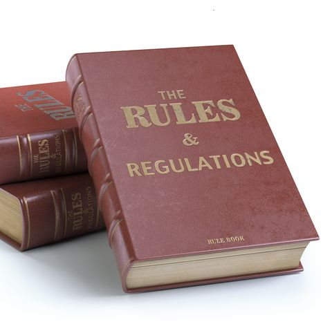 rules and regulations books with official instructions and directions of organization or team isolated on white background