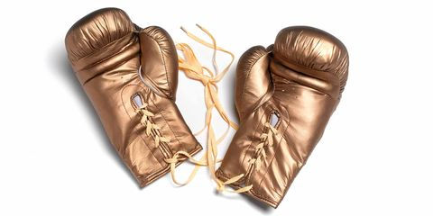 Boxing glove, Glove, Personal protective equipment, Boxing equipment, Leather, Fashion accessory, Sports equipment, Metal,