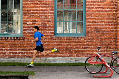 Bicycle frame, Bicycle tire, Bicycle wheel rim, Brick, Window, Bicycle handlebar, Bicycle fork, Bicycle wheel, Human leg, Bicycle accessory,