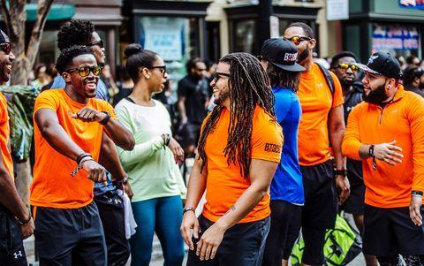People, Yellow, Crowd, Youth, Event, Orange, Community, Street, Public event, Fun,