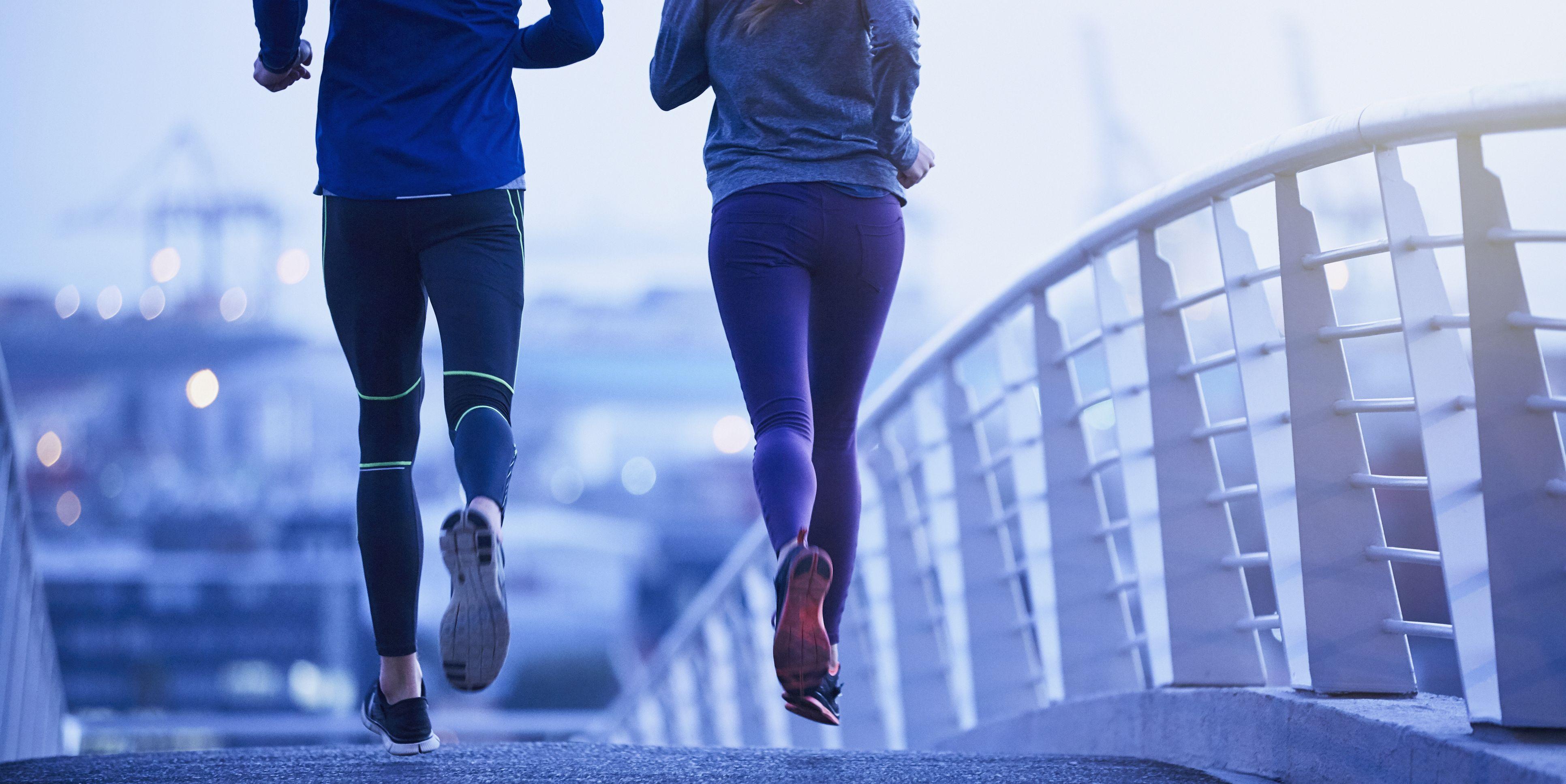 Runner-couple-running-on-urban-footbridge-at-dawn-royalty-free-image-691051677-1531864532.jpg?crop=1.00xw:0.751xh;0,0