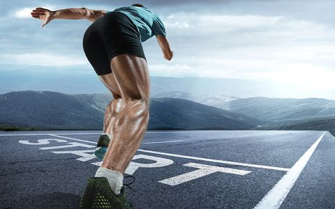 The close up feet of man running and training on running track with word start