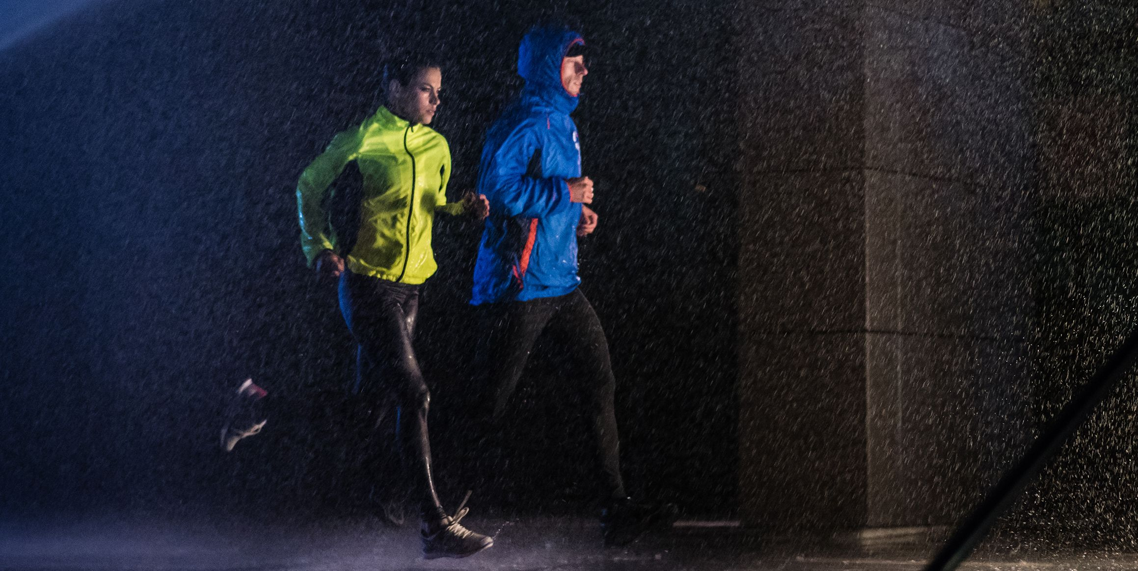 runners in rain jackets