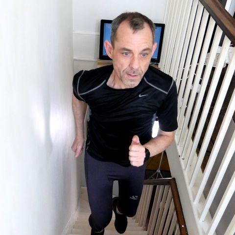 man runs height of everest