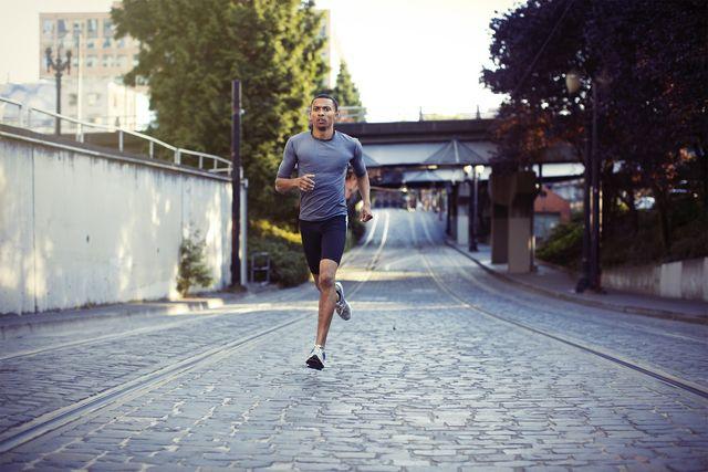 Road surface, Human leg, Asphalt, Running, Public space, Athletic shoe, Knee, Active shorts, Grey, Endurance sports,