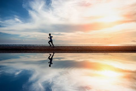 Running exercise healthy lifestyle on the summer beach. Exercise health concept.
