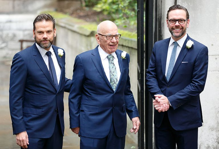 Lachlan Murdoch, at left, and James Murdoch flank their father Rupert at his 2016 wedding.