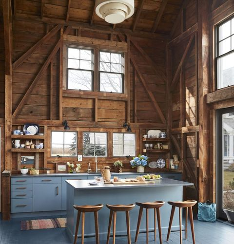 rustic kitchen with blue painted floor and blue cabinets