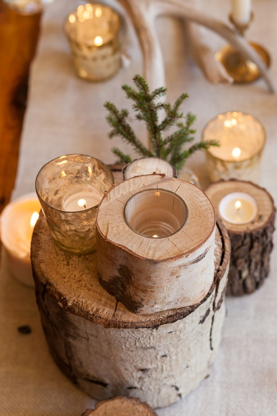 16 easy rustic centerpieces for winter christmas table decorations rh elledecor com winter table decorating winter party centerpieces