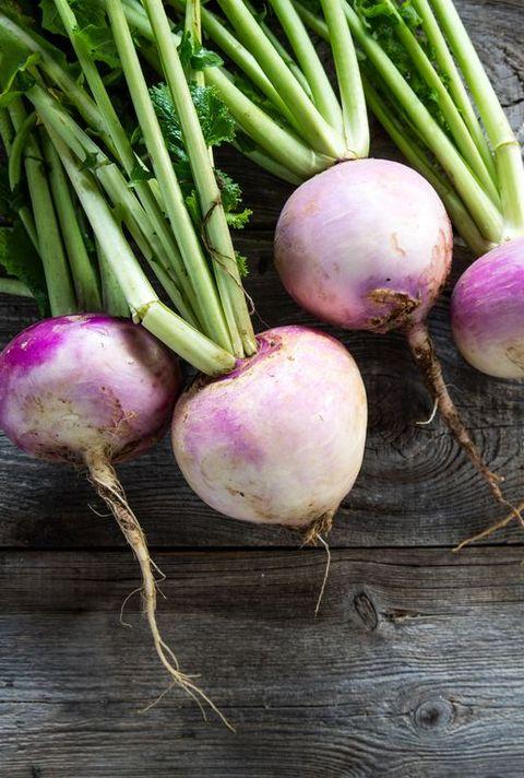 rusticorganic turnips on genuine wood background for vegetarian food
