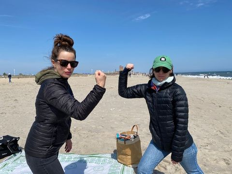 ruthie and me flexing at jacob riis park on april 19, about a month into our pushup challenge