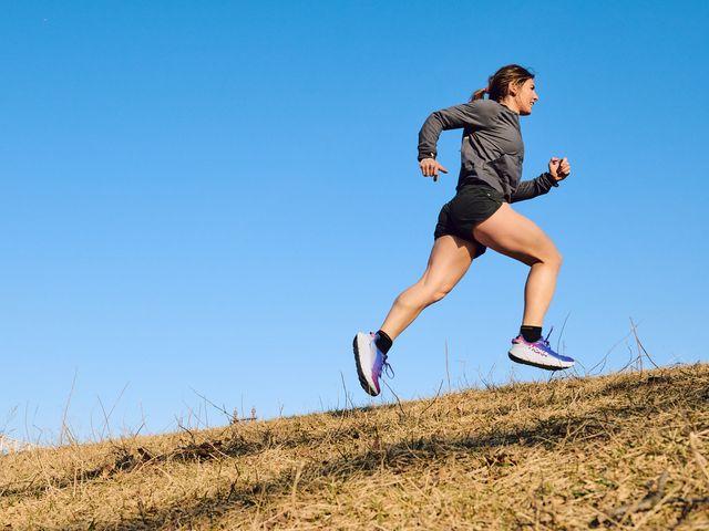 coach jess running up a hill