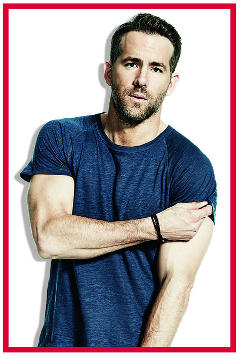 ryan reynolds, actor, wearing a blue t shirt and faded black jeans