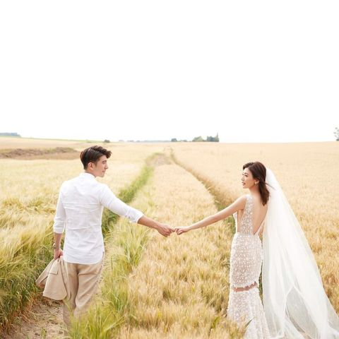 People in nature, Photograph, Wedding dress, Dress, Bride, Grass family, Interaction, Bridal clothing, Gesture, Photography,