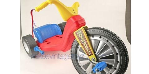 Vehicle, Tire, Toy, Tricycle, Automotive tire, Spoke, Wheel, Motorcycle, Bicycle part, Rim,