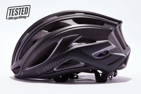 Helmet, Motorcycle helmet, Personal protective equipment, Clothing, Bicycle helmet, Headgear, Sports equipment, Automotive design, Material property, Font,