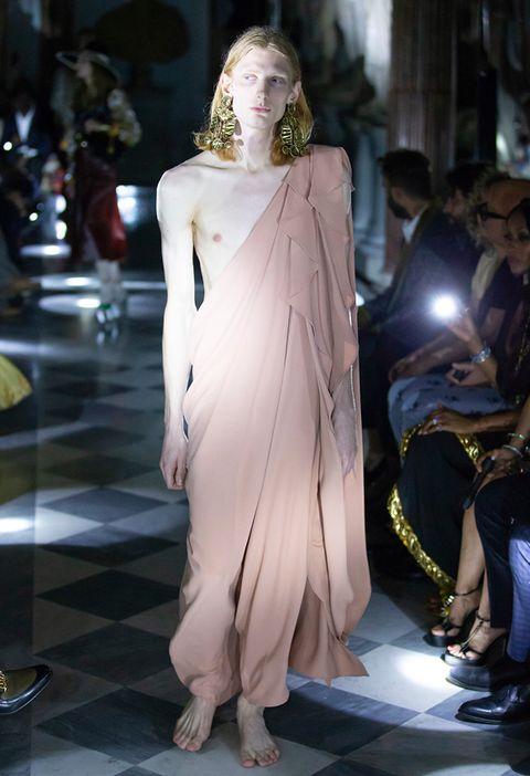 Fashion model, Fashion, Haute couture, Shoulder, Dress, Runway, Joint, Fashion show, Fashion design, Gown,