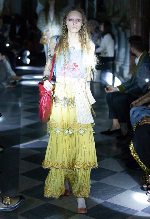 Fashion, Fashion model, Fashion show, Clothing, Haute couture, Runway, Yellow, Fashion design, Dress, Event,