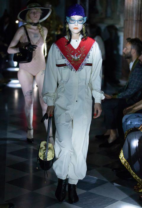 Fashion, Outerwear, Headgear, Costume, Fashion design, Helmet, Haute couture, Runway, Event, Uniform,
