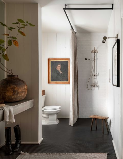 black tiles, white painted bathroom, brick and wood panelling