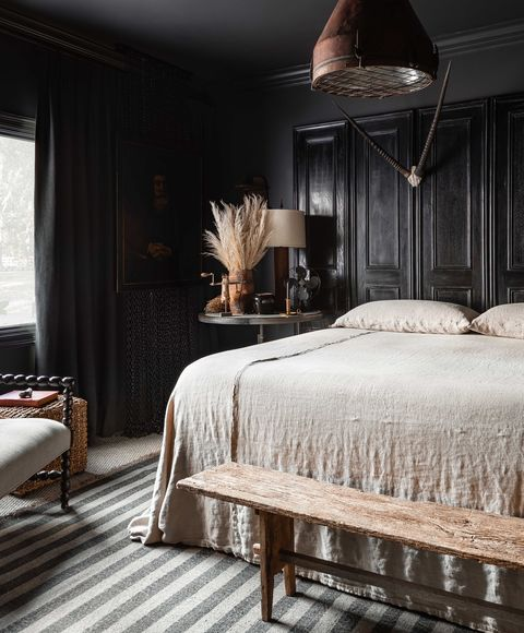 black painted walls, black crown moulding, black and white striped rug, cream linen