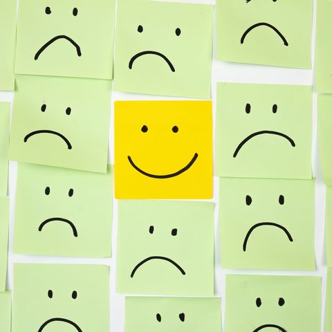 sad faces on sticky notes with one happy one