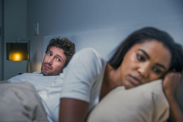 sad woman ignoring man at home
