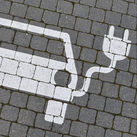 16 january 2020, brandenburg, grünheide a pictogram for a parking space for an electric vehicle can be seen on the street on the same day, the us electric car manufacturer tesla opens a citizens' information office in the town's market square tesla is planning to build a gigafactory in a huge forest area, east of the a10 berlin ring motorway in the community of grünheide in a first phase from summer 2021, 150,000 model 3 and y electric cars are to be built there annually photo patrick pleuldpa zentralbildzb photo by patrick pleulpicture alliance via getty images