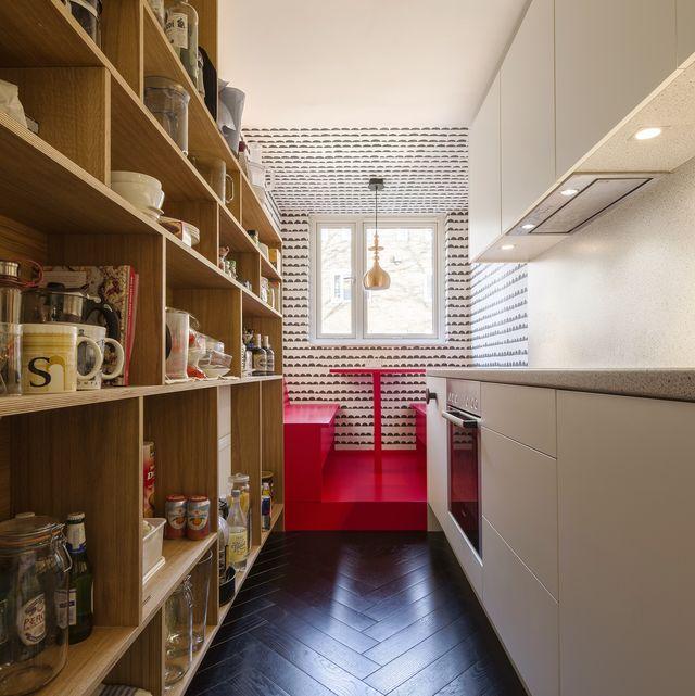 Narrow kitchen dining area in a London home by Filippo Architekten