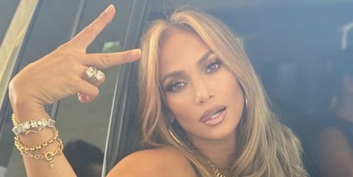 Jennifer Lopez Showed Off Her Abs on the 'Shotgun Wedding' Set in a Crop Top and Gold Joggers