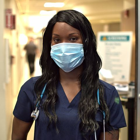 nurse wears a mask