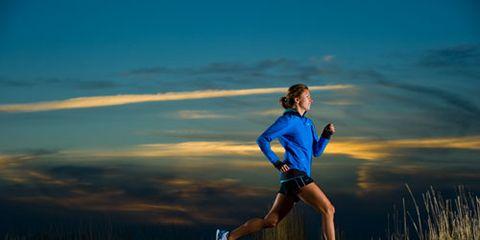 Woman running at night alone