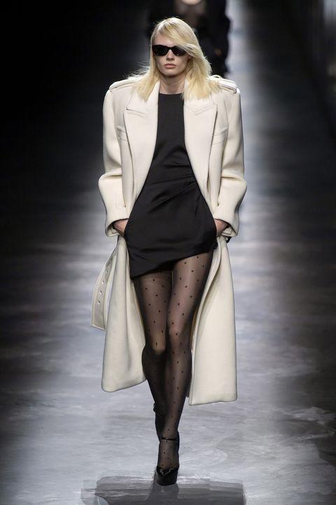 Fashion model, Fashion, Fashion show, Runway, Clothing, White, Outerwear, Leg, Coat, Public event,