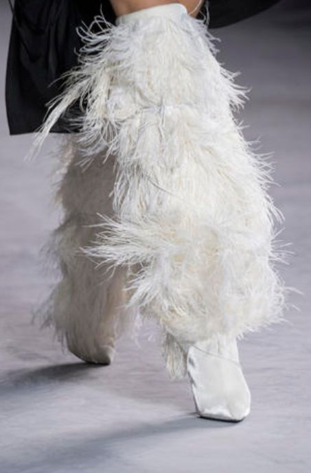 White, Fur, Fashion, Feather, Haute couture, Outerwear, Footwear, Textile, Dress, Tail,
