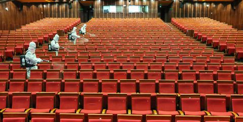 topshot   this photo taken on may 12, 2020 shows staff members spraying disinfectant at a theatre as it prepares to reopen in yantai in china's eastern shandong province   china's top decision making body has given the green light for cinemas, entertainment venues and sports facilities nationwide to reopen after several months of closures photo by str  afp  china out photo by strafp via getty images