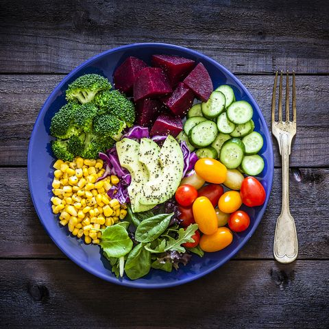 Salad mix plate shot from above on rustic wooden table