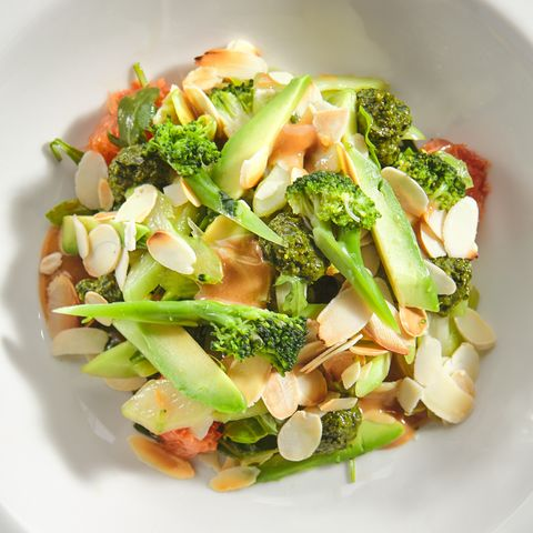 salad with avocado, broccoli, cucumber and almonds isolated