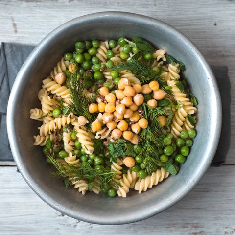 Salad with fusilli, chickpeas, grass in a metal bowl